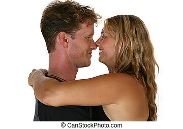 Caucasian couple give a happy hug and smile
