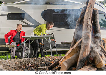 Caucasian Couple Having Fun in Front of Campfire