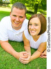 Caucasian Couple Smiling Look At Camera