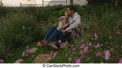 Caucasian couple spending time in a garden