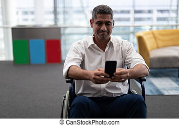 Caucasian disabled businessman using mobile phone while ...