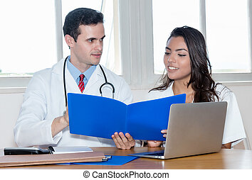 Caucasian doctor with nurse preparing for surgery