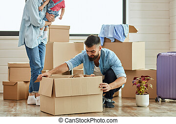 Caucasian family move in new house