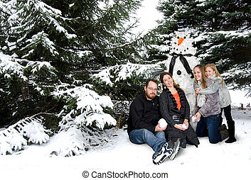 Caucasian family with tree