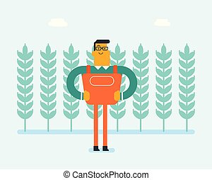 Caucasian farmer standing in a wheat plantation.