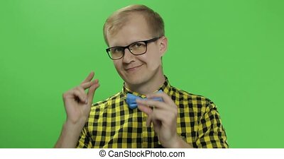Caucasian fashionable man shows fingers in the camera. Guy...