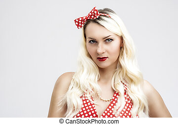 Caucasian Female Blond Woman Posing in Pinup Style Clothes Against White Background