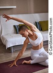 Caucasian female doing exercise on mat