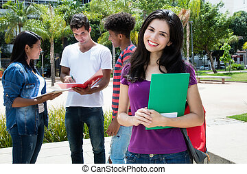 Caucasian female student with group of other international students