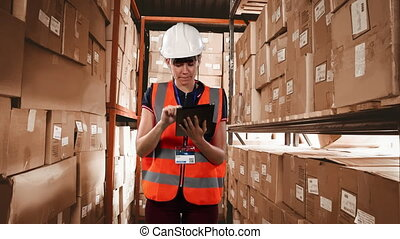 Animation of Caucasian female worker wearing a hard hat and high visibility vest counting stock on shelves and using tablet computer, in a warehouse storage space, digital composite