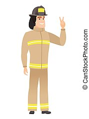 Caucasian firefighter showing the victory gesture.