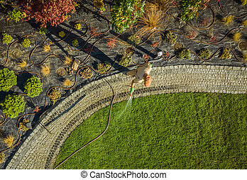 Garden Industry Worker Watering Newly Installed Natural Grass