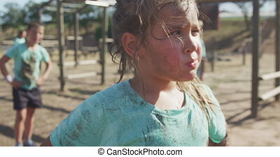 Caucasian girl at boot camp - Side view of a Caucasian girl ...