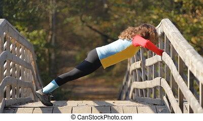 girl doing push ups - caucasian girl doing push ups on a...