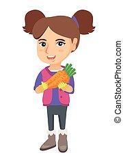 Caucasian girl holding fresh carrot.