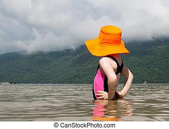 Caucasian girl looking at the lake