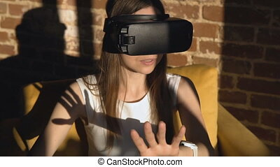 Caucasian Girl Sets Virtual Reality Helm - Dark hair...
