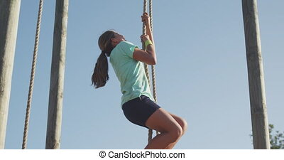 Caucasian girl training at boot camp - Side view of a ...