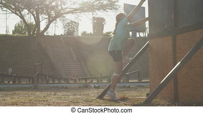 Caucasian girl training at boot camp - Side view of two ...