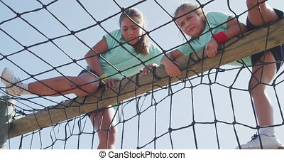 Caucasian girls training at boot camp - Low angle view of ...