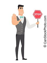 Caucasian groom holding stop road sign.