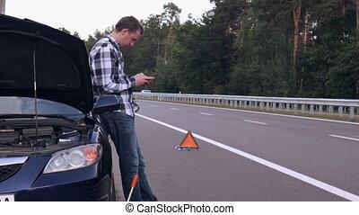 caucasian guy near broken car roadside. - Handsome man stuck...