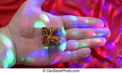 Caucasian hand holding small present box