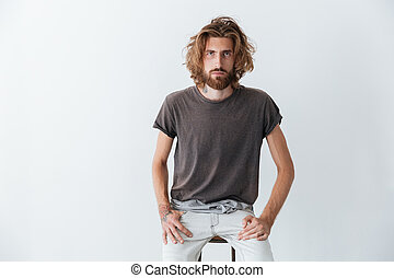 Caucasian handsome young bearded man standing isolated