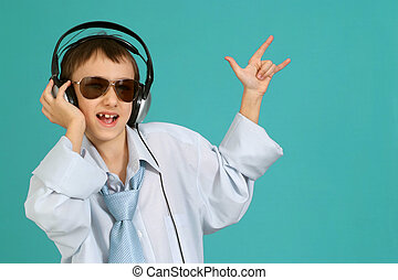 Caucasian handsome young man with headphones posing