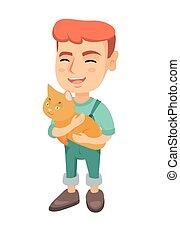 Caucasian happy boy holding a cat.