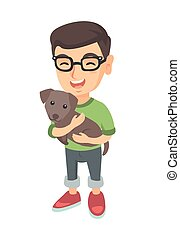 Caucasian happy boy in glasses holding a dog.