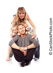 Caucasian happy smiling young family with two children sitting on the floor