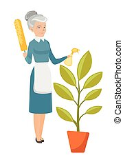 Caucasian housemaid watering flower with spray.