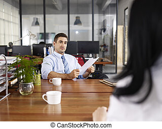 caucasian hr manager conducting an interview