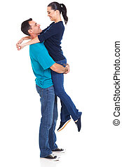caucasian husband lifting his wife
