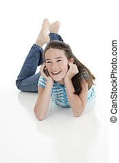 Caucasian Kids - Cute Caucasian girl talking on a cell phone