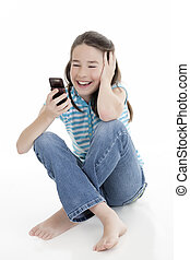 Caucasian Kids - Cute Caucasian girls texting on a cell...