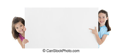 Caucasian Kids - Two Cute Caucasian girls holding a blank...