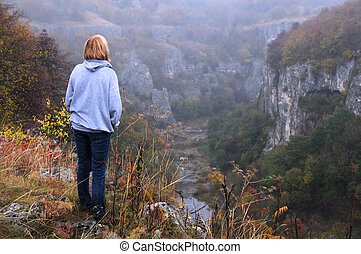 Caucasian Lady on the Edge of the Canyon