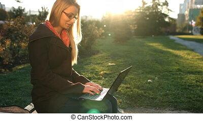 Caucasian lady working on laptop