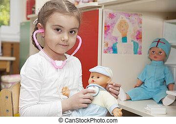 Caucasian little girl playing doctor