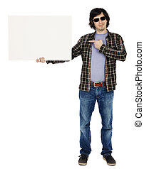 Caucasian male in his early 30's dressed in a casual attire and holding a blank white sign with one hand while pointing at it with the other, apparently looking at the camera through his sunglasses w
