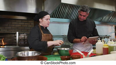 Caucasian man and woman cooking - Front view of a Caucasian...