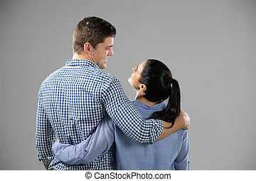 Caucasian man and woman on grey background
