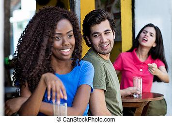 Caucasian man flirting with african american woman