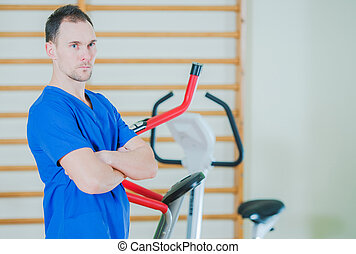 Caucasian Man Getting Ready To Use Fitness Bike At Gym.