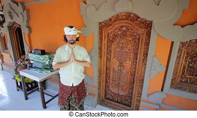caucasian man in balinese clothes