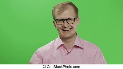 Caucasian man in pink shirt show thumbs up. Chroma key -...