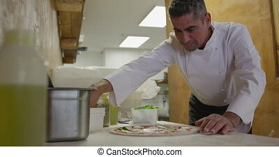 Caucasian man making a pizza - Side view mid section of a...