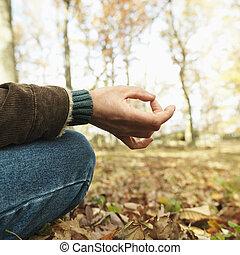 Caucasian man meditating. - Caucasian man sitting on ground ...